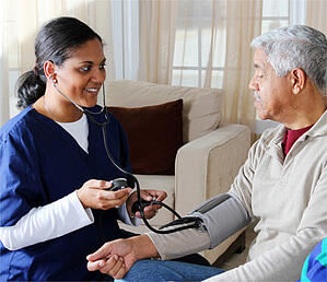 CNA Taking Patients Blood Pressure