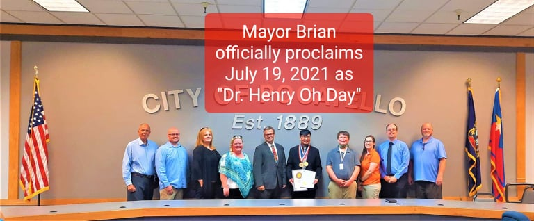 Dr. Henry Oh, Mayor Brian, and City Council of Pocatello stand in a line.